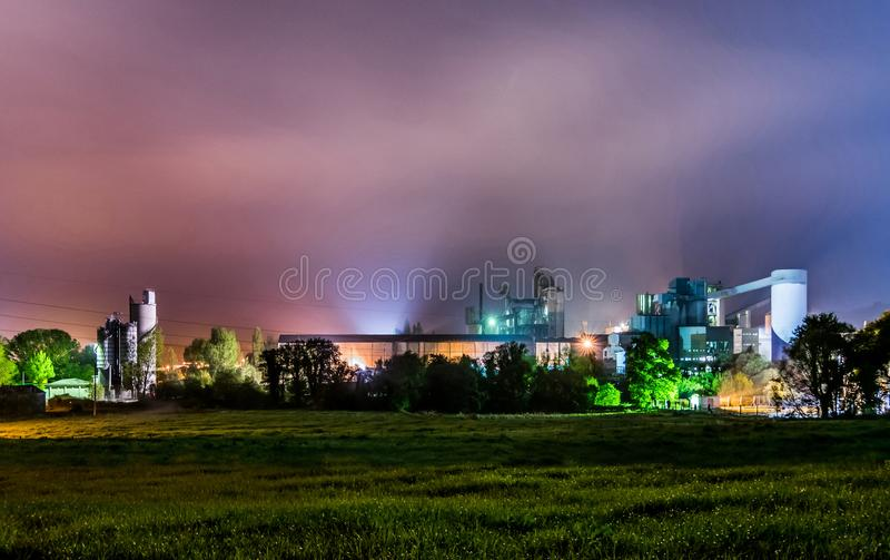 Cement plant at night stock photos