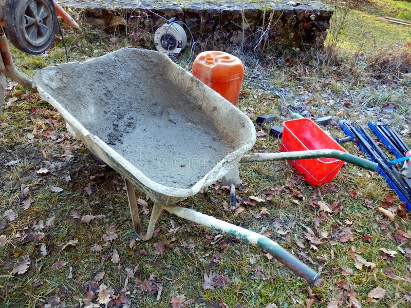 Cement Preparation Equipment. Wheelbarrow used to transport cement from the cement mixer stock photo