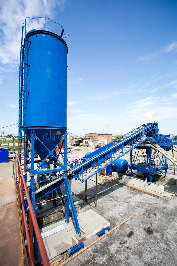 Cement production in quarry. Small factory, vertical stock photography