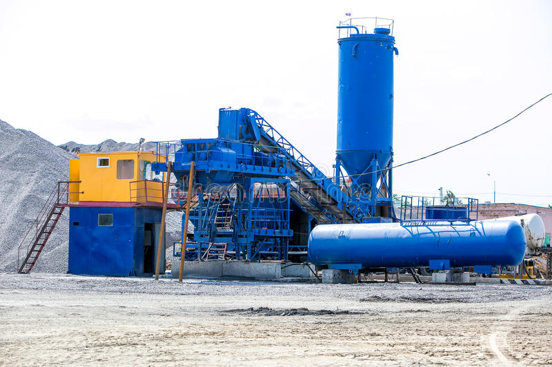 Cement production in quarry. Cement production in stone quarry, small factory royalty free stock photography