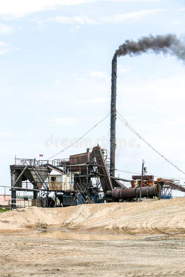 Cement production in quarry. Cement production in stone quarry with smoke royalty free stock image