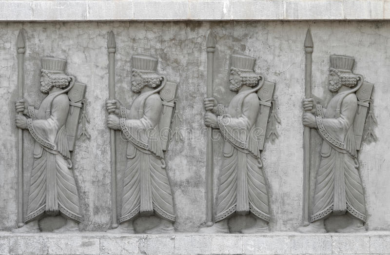 Cement relief. Achaemenid soldiers, cement relief on wall royalty free stock photography