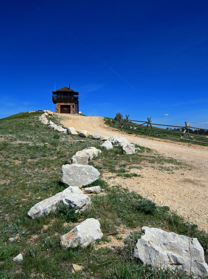 Cement Ridge Fire Lookout Tower with limestone granite boulders lining dirt road in the Black Hills of South Dakota royalty free stock photo