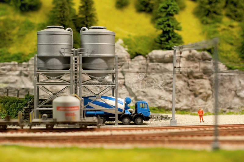 Cement silos. Miniature model cement truck loading from track-side silos stock photo
