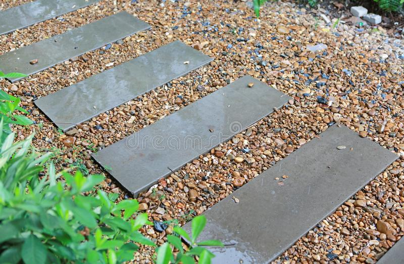 Cement stairs in the garden are wet from the rain. Slip surface stock photos