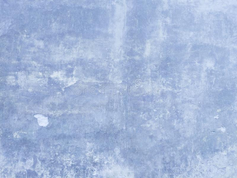 Pantone Classic Blue Background Cement Wall. Cement wall with texture done in Pantone Classic Blue color with streaks of grey and light blue stock photo