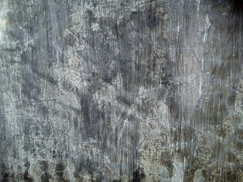 Cementi il fondo approssimativo sporco scuro di lerciume di struttura della parete immagine stock