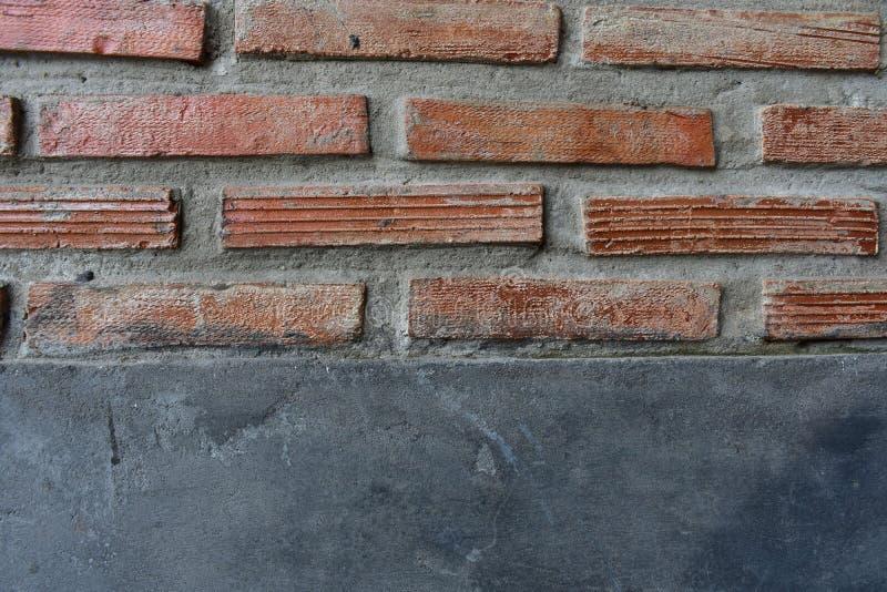 Cementmuur met rode baksteen royalty-vrije stock foto