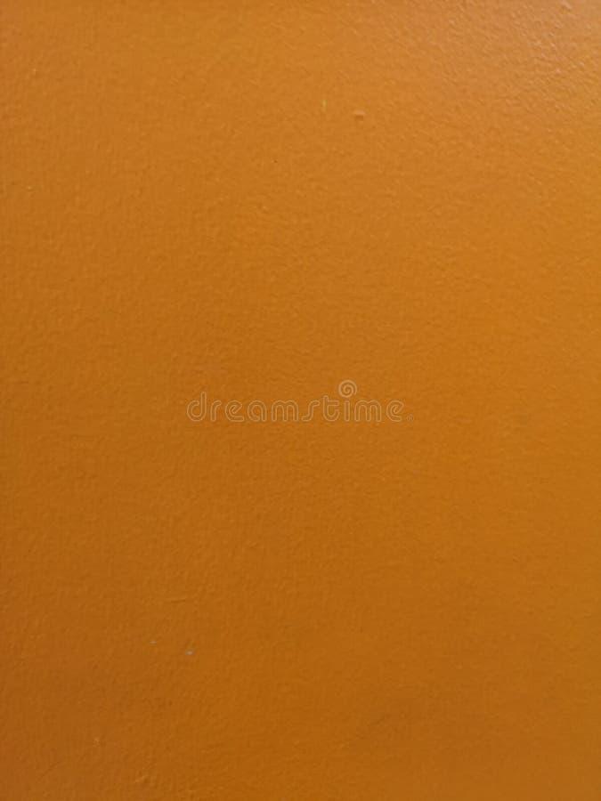 Cementowego ściennego szorstkiej powierzchni tekstury tła betonu koloru farby materialny żółty projekt dekoruje zdjęcia stock
