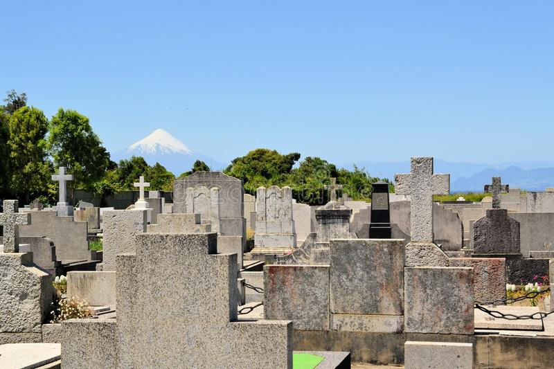 Cemetary with Volcano Osorno, lake Llanquihue. Cemetary of German immigrants with Volcano Osorno with lake Llanquihue seen from Puerto Varas, Patagonia, Chile stock photo
