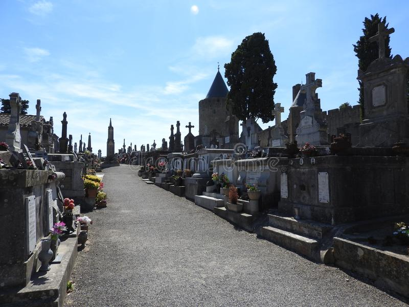 Cemetery in the ancient city of Carcassonne. Cemetery in the ancient city of Carcassonne located in France, with its Catholic Cathedral, the mighty stone walls royalty free stock image