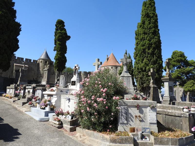 Cemetery in the ancient city of Carcassonne. Cemetery in the ancient city of Carcassonne located in France, with its Catholic Cathedral, the mighty stone walls royalty free stock photography