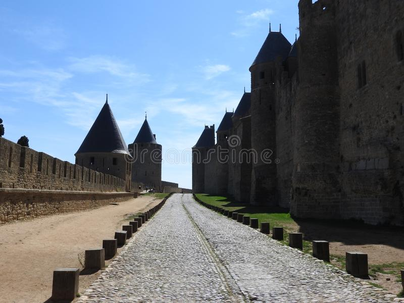 Cemetery in the ancient city of Carcassonne. Cemetery in the ancient city of Carcassonne located in France, with its Catholic Cathedral, the mighty stone walls stock photo
