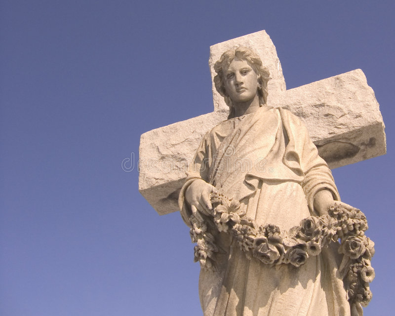 Cemetery Angel. Cemetery Sculpture of angel with wreath royalty free stock images