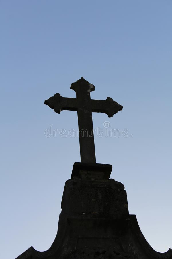 Cemetery cross under blue sky stock photo