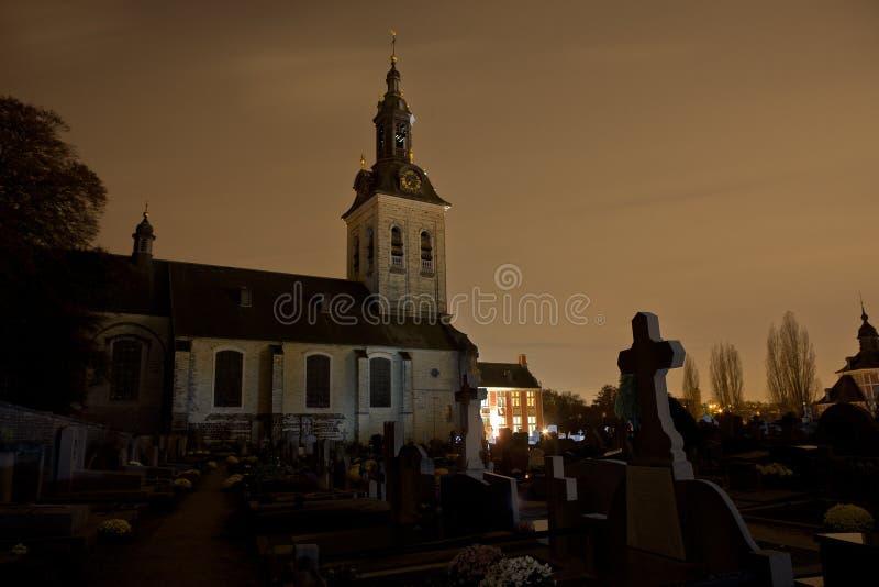 Cemetery graveyard church night, Leuven, Belgium royalty free stock photography
