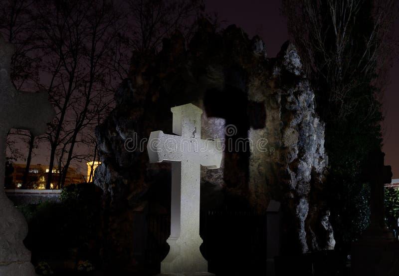 Cemetery graveyard tombstone cross night, Leuven, Belgium stock images