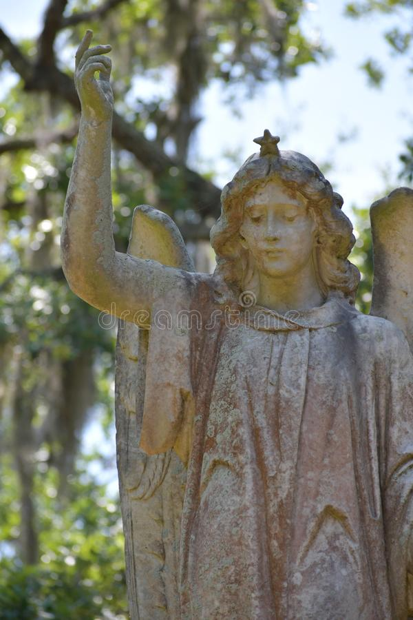 Cemetery Headstone at Savannah Georgia historic cemetery. Granite headstone of angel with star crown featured at the oldest cemetery in Savannah Georgia royalty free stock images