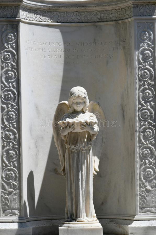 Cemetery Headstone at Savannah Georgia historic cemetery. Granite headstone with winged angel playing harp featured at the oldest cemetery in Savannah Georgia stock photo