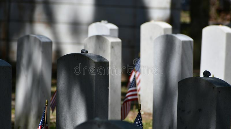Cemetery Headstone at Savannah Georgia historic cemetery. Granite headstones honoring fallen soldiers featured at the oldest cemetery in Savannah Georgia royalty free stock photography