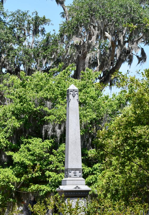 Cemetery Headstone at Savannah Georgia historic cemetery. White alabaster marble granite obelisk headstone featured at the oldest cemetery in Savannah Georgia stock images
