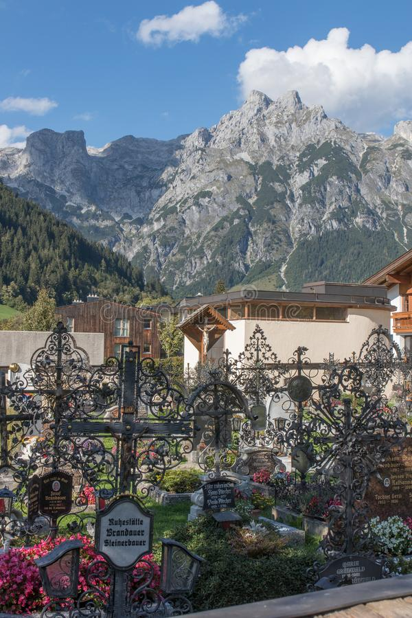 Cemetery with mountains behind, Werfenweng stock photography