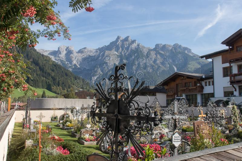 Cemetery with mountains behind, Werfenweng royalty free stock photos