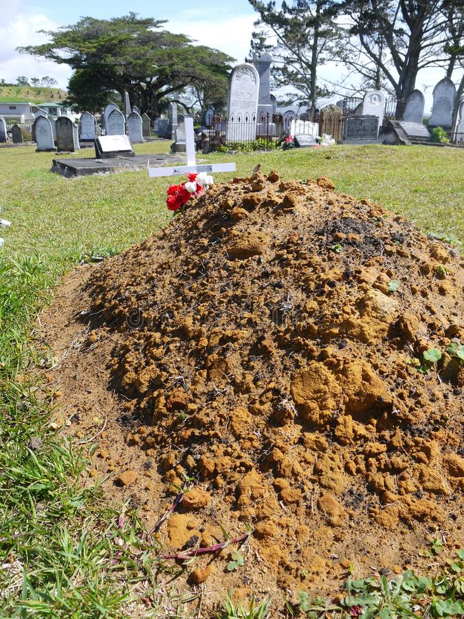 Cemetery: new grave and old headstones stock photo