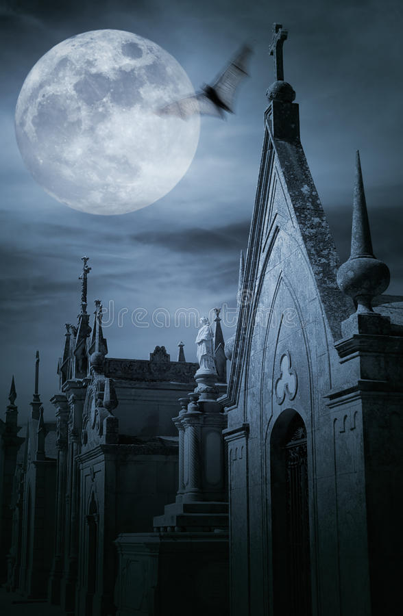 Cemetery at night. Old european cemetery in a full moon night stock photography