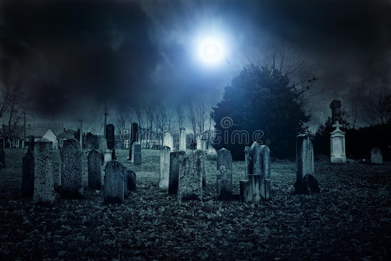 Cemetery night. Haunted and creepy old cemetery at night stock images