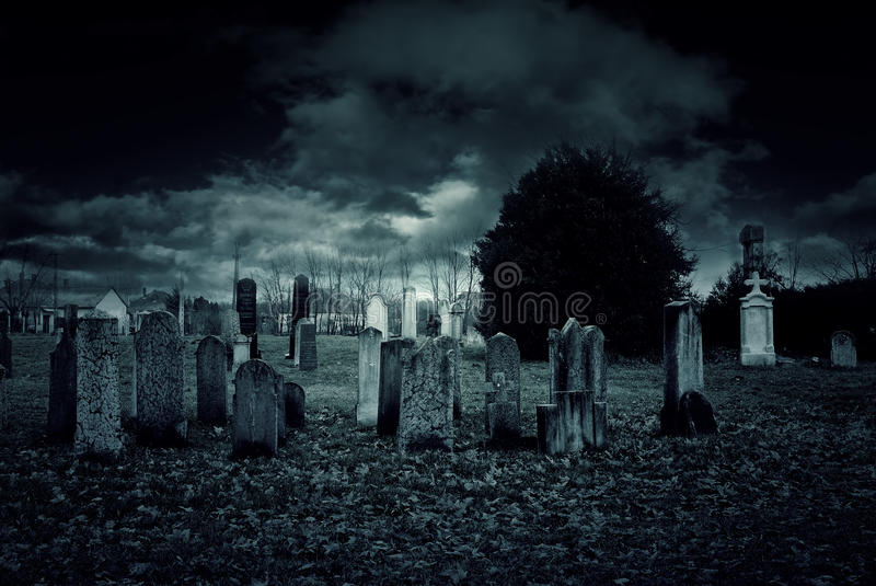 Cemetery night. Haunted and creepy old cemetery at night royalty free stock photos
