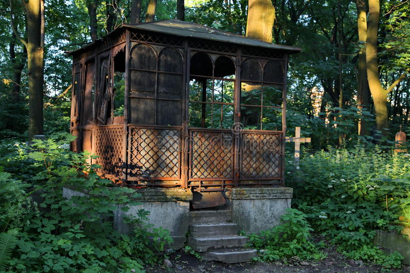 In the cemetery. Old abandoned iron brocken crypt. stock image