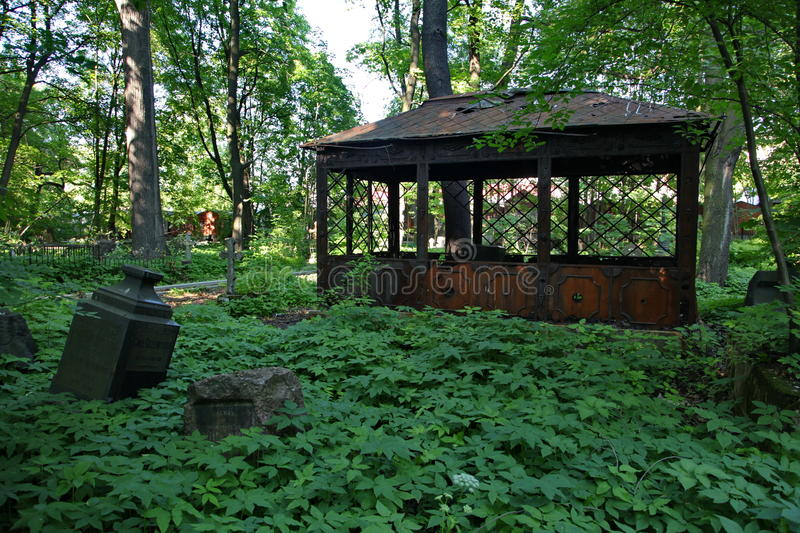 In the cemetery. Old abandoned iron brocken crypt. stock photography