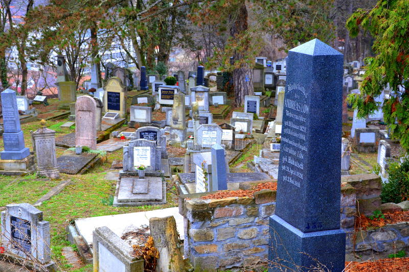 Cemetery of the old medieval saxon lutheran church in Sighisoara, Transylvania, Romania stock images