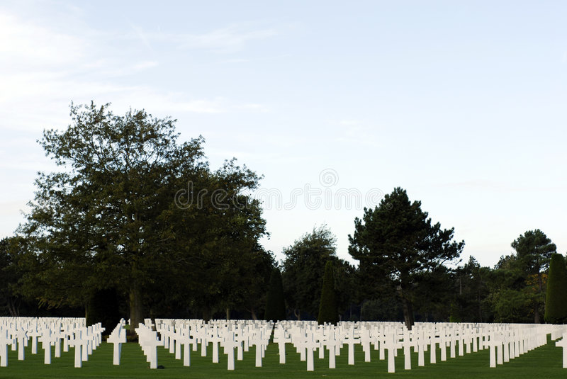 Cemetery At Omaha Beach in Normandy. White marble grave stones at the American Cemetery near Omaha Beach in Normandy, France royalty free stock photography