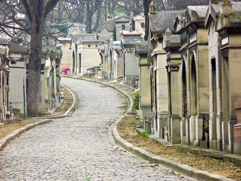 Cemetery of Pere Lachaise, Paris, France. Typical view of cobble stone streets in Paris most famous and largest cemetery, Pére Lachaise, holding the graves of stock photography