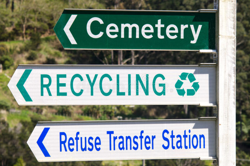Cemetery and Recycling Station Street Signs. Cemetery , recycling station and refuse transfer station street signs pointing to the same direction stock photos