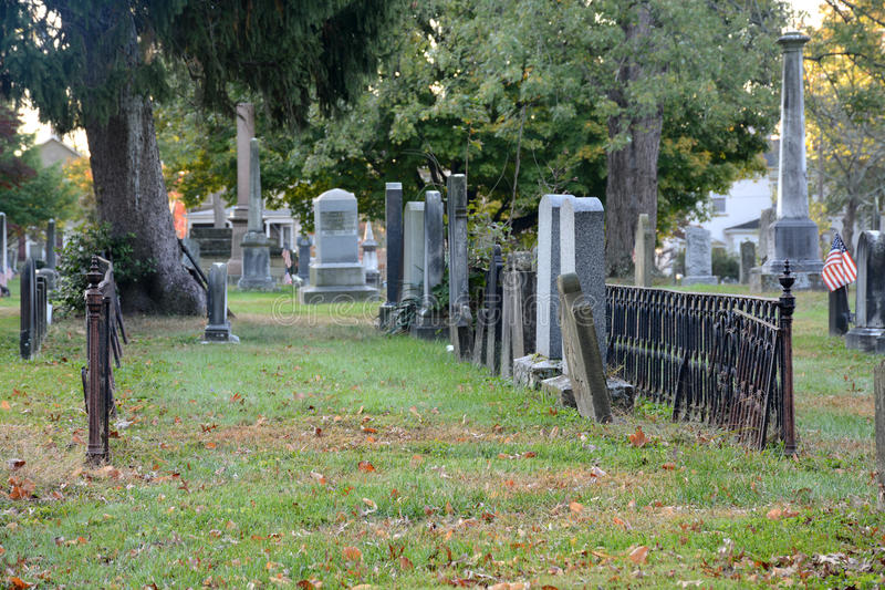 Cemetery. Row of headstones in an historic cemetery in Marietta Ohio separated from the rest of the graves by a small iron fence royalty free stock images
