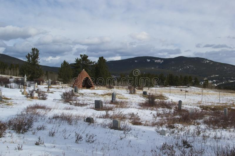 Cemetery in the snowy mountains stock images