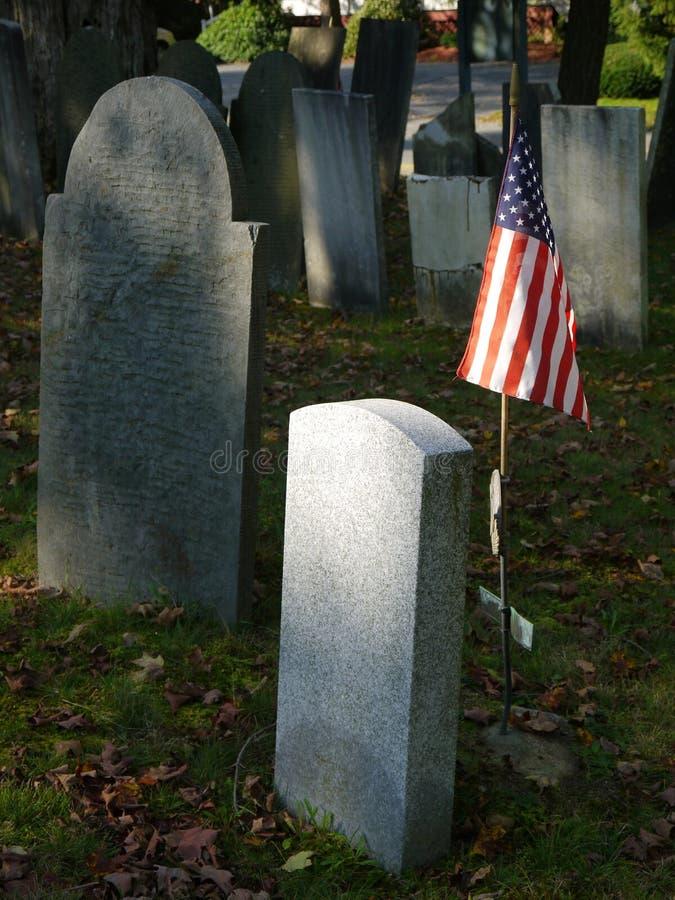 Cemetery: U.S. flag with blank gravestones stock photography