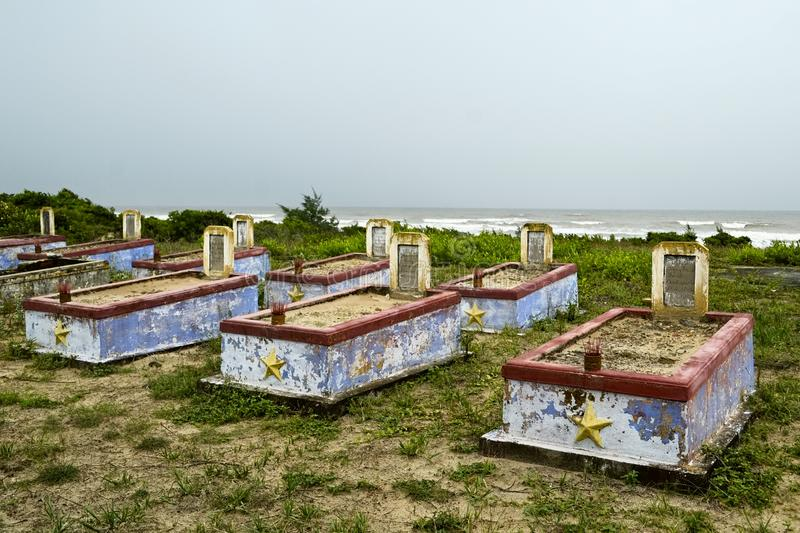 Cemetery of the Vietnam War with old weathered  tombstones stock photography