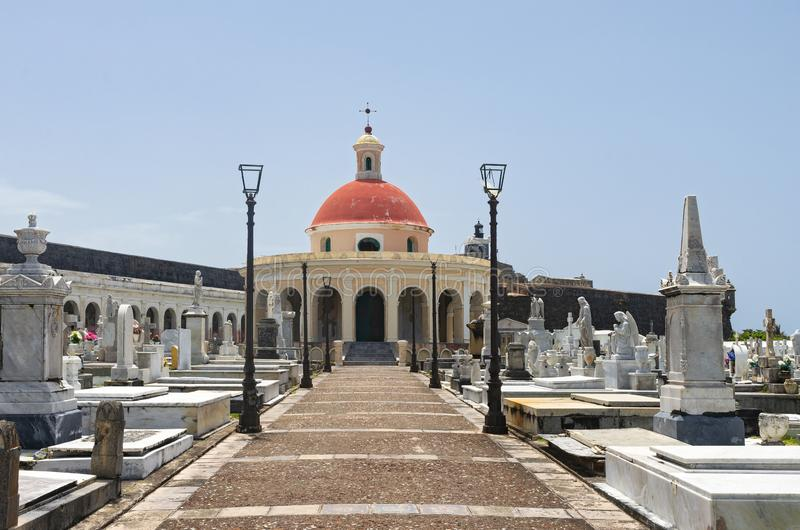 Cemetery and Walkway to Chapel in Old San Juan. Walkway leading to chapel and past gravesites in landmark cemetery santa maria magdalena de pazzis in old san royalty free stock photography