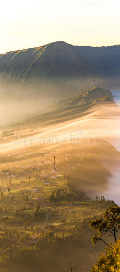Cemoro Lawang; small village in morning mist. Which situated on the edge of massive north-east of Mount Bromo, East Java, Indonesi. A royalty free stock photo
