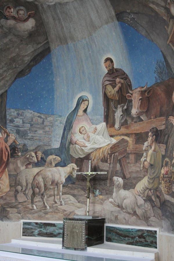 Cena da natividade na igreja do campo dos pastores, Bethleh fotografia de stock royalty free