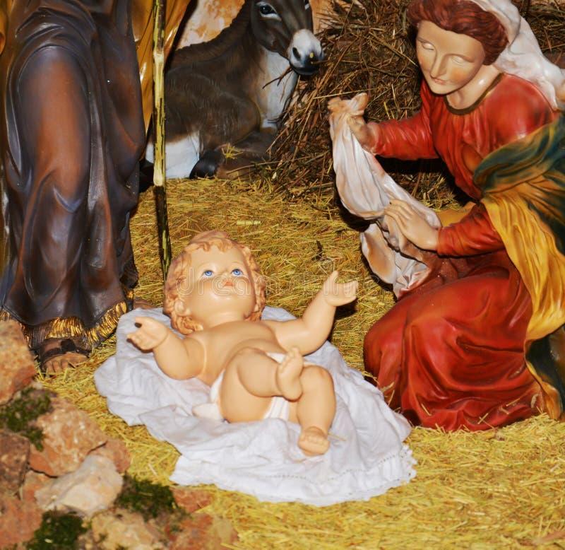 Cena da natividade, nascimento santamente e criança fotografia de stock
