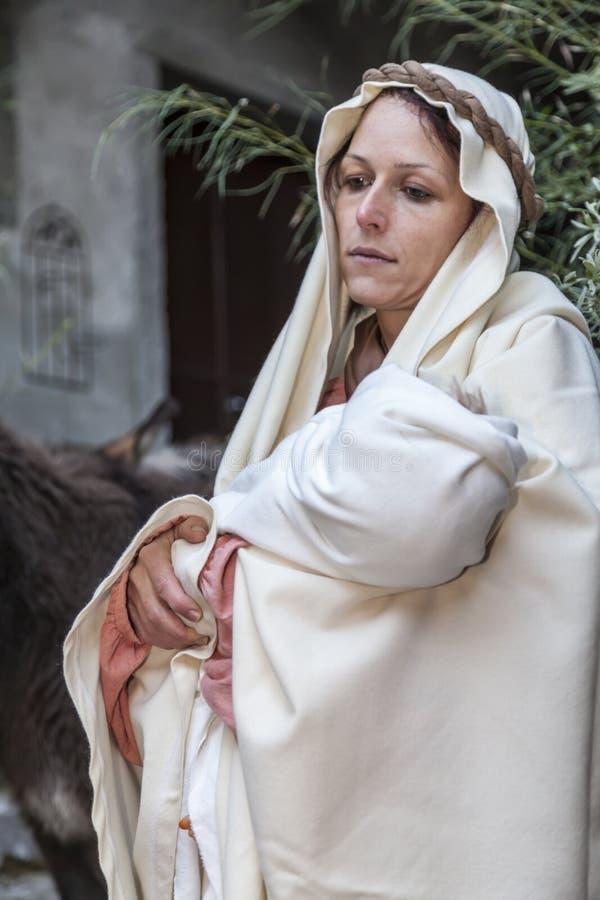 Cena da vida de Jesus O vôo em Egipto O Virgin leva Jesus em seu braço imagens de stock