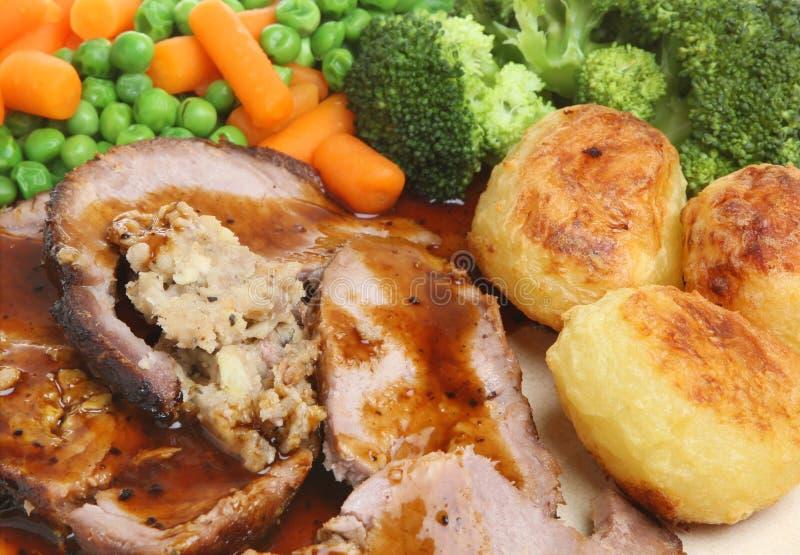 Cena rellena carne asada del cerdo fotografía de archivo libre de regalías