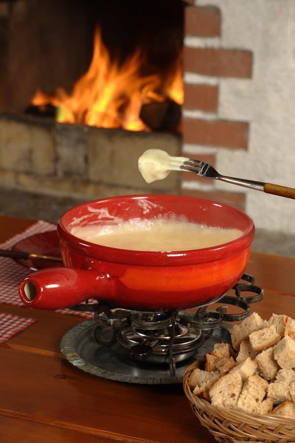 Cena suiza de la 'fondue' imagen de archivo libre de regalías