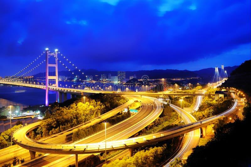 Cenas da noite da ponte de Tsing miliampère imagens de stock royalty free