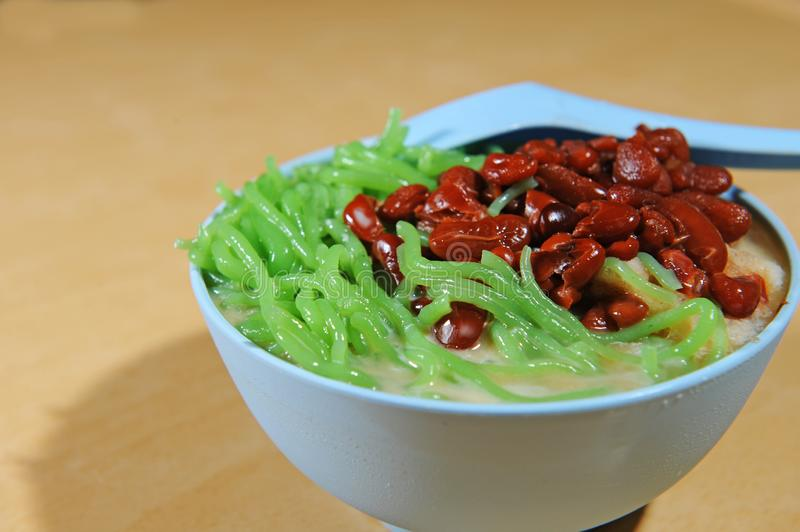 CENDOL. Is an iced sweet dessert that contains droplets of green rice flour jelly, coconut milk and palm sugar syrup. It is commonly found in Southeast Asia and stock photos
